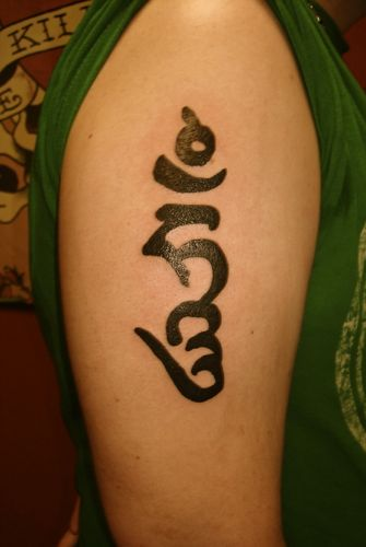 Tibetan words; two Buddhist terms written in U-chen. Tibetan tattoos,Tibetan