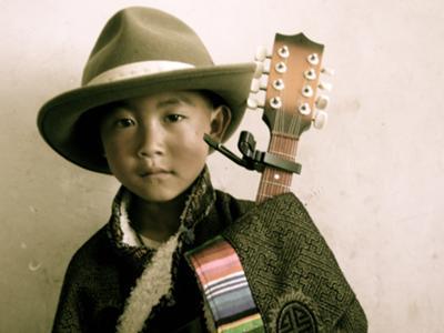 Nomad Child with Mandolin in Amdo, Tibet